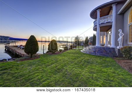 Luxurious Waterfront Home Backyard View At Sunset