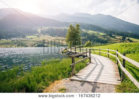 Great mist view of the alpine valley with Haidersee lake. Picturesque and gorgeous morning scene. Location place San Valentino Alla Muta village, Bolzano, South Tyrol, Italy alp, Europe. Beauty world.