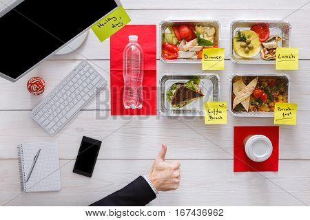 Healthy eating. Restaurant food delivery, business lunch and diet plan, fresh daily meals with stickers in office at workplace. Vegetables, meat and fruits in foil boxes. Top view, flat lay on wood