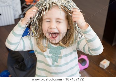Child With Metal Party Wig Shouting