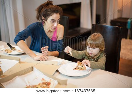 Child Surprise Face With A Pizza Broken Piece With Mother
