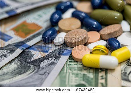 medical pills on american dollars close up