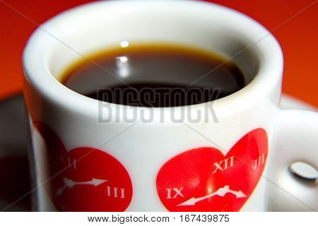 Cup with hearts. It is time to drink coffee. Figure hours at heart.