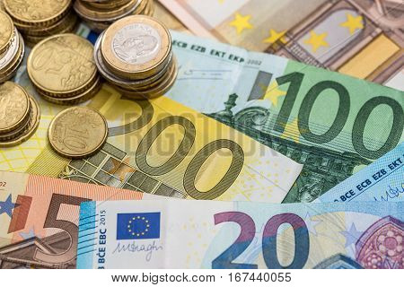 Euros banknotes and euro coins close up