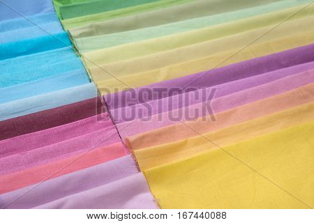 Color fabric palette as background close up