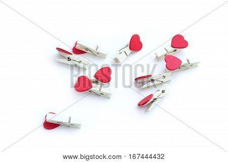 wooden clothes pin or cloth pegs with heart shape design for valentine object on a white background