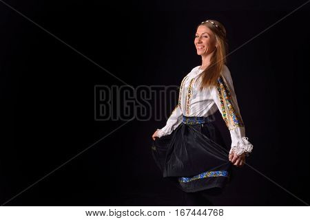 Closeup Of A Young Romanian Woman Dressed In Traditional Costume, Holding His Skirt On Her Hands And