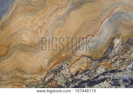 Mineral background. Folded quartzite stone macro detail. Geology gemstone. Horizontal