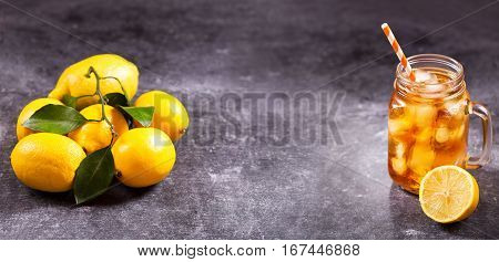Glass Jar Of Iced Tea With Fresh Lemons