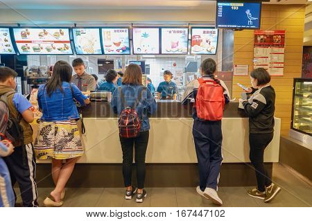 SHENZHEN, CHINA - CIRCA DECEMBER, 2016:  counter service in a McDonald's restaurant. McDonald's is an American hamburger and fast food restaurant chain.