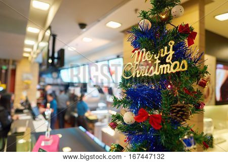 SHENZHEN, CHINA - CIRCA DECEMBER, 2016: Christmas tree at a McDonald's restaurant. McDonald's is an American hamburger and fast food restaurant chain.