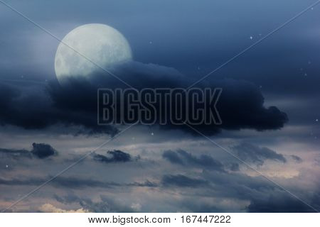 bright night sky with a full moon, stars and clouds