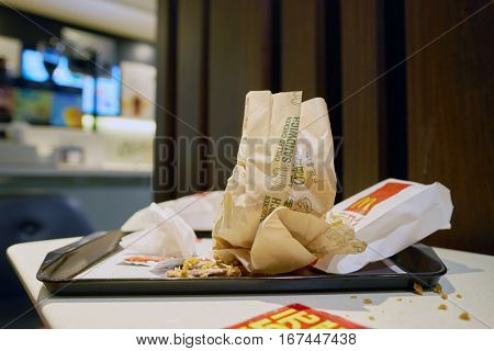 SHENZHEN, CHINA - CIRCA DECEMBER, 2016: left food tray at McDonald's restaurant. McDonald's is an American hamburger and fast food restaurant chain.