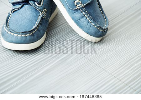 Blue moccasins for a boy. Beautiful shoes