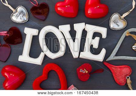 Valentines day hearts on dark wooden background