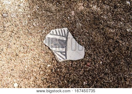 Native American Anasazi pottery shard on the ground