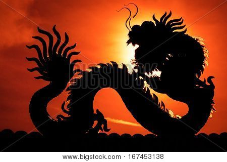 Chinese Dragon. - A Silhouette Image Of Chinese Dragon Statue In Dragon Chinese Temple. Sun Dragon P