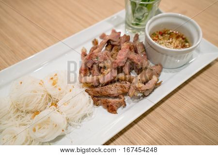 Thai Style Grilled Pork Neck With Noodle And Spicy Sauce. Thai Cuisine.
