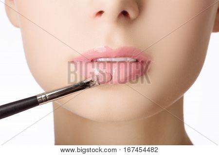Beauty face closeup. Making sexy lips. Beauty pink lip makeup detail. Beautiful make-up close-up. Sensual open mouth. Lipstick and lipgloss