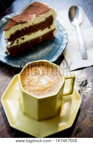 coffee cup and Chocolate cake in coffee shop