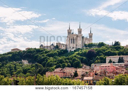 Colorful houses of Lyon and Fourviere Basilica from the Saone riverbank, France.