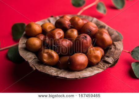 Organic Indian Jujube or ber or berry (Ziziphus mauritiana) moody lighting, selective focus