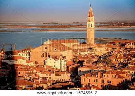 Panoramic aerial cityscape of Venice,with rooftops, the sea at sunset, Veneto, Italy.