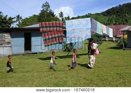 Indigenous Fijian Woman And Her Children In A Local Village Fiji