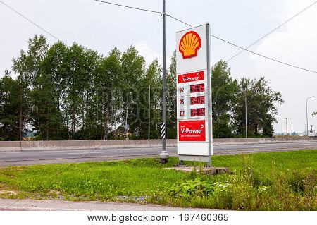 LENINGRAD REGION RUSSIA - JULY 31 2016: Guide sign indicates the price of the fuel on the gas station Shell. Shell is an Anglo-Dutch multinational oil and gas company