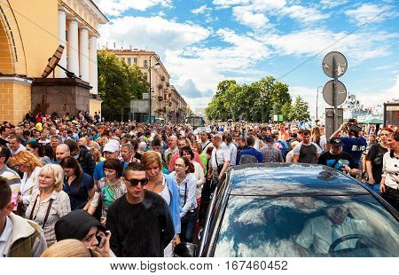 SAINT PETERSBURG RUSSIA - JULY 31 2016: People celebrate the Navy day at the Admiralty embankment in sunny day
