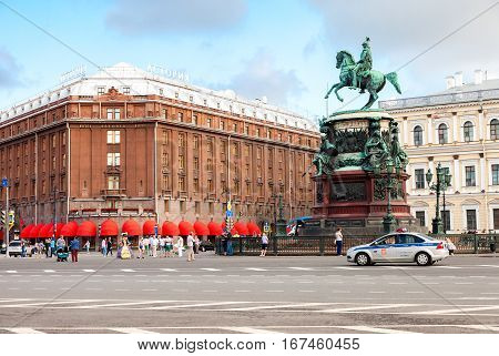 ST.PETERSBURG RUSSIA - JULY 31 2016: Famous hotel Astoria and bronze monument of russian emperor Nicholas I. Historical center of Saint Petersburg