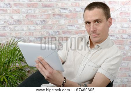 A an handsome man using tablet computer