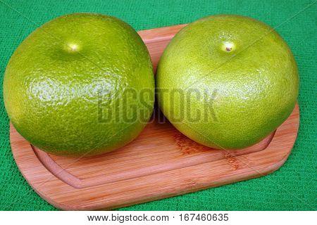 Two Fresh Sweetie On A Wooden Board
