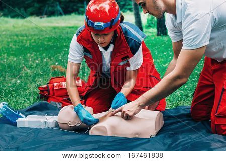 cpr training outdoors, in park, color image
