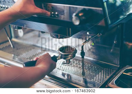 Barista Using Coffee Machine Preparing Fresh Coffee Or Latte Art