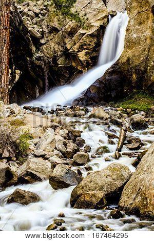 Waterfall flowing over rocks in Estes Park Colorado