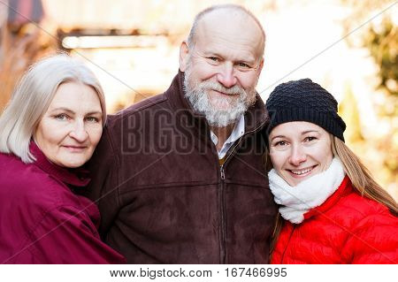 Happy elderly couple with the young carer