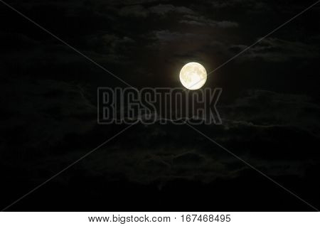 Moon with clouds at night, darkness and gloom