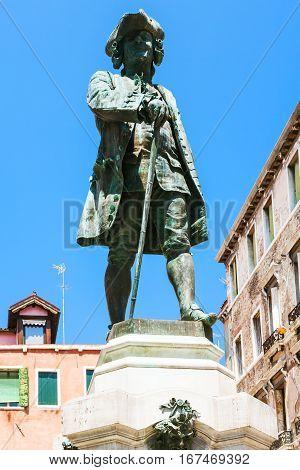 travel to Italy - bronze sculpture of Carlo Goldoni on Campo S Bartolomeo in Venice city