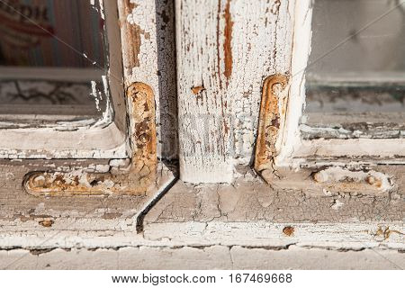 wooden retro old window close-up with texture shabby paint repair replacement windows