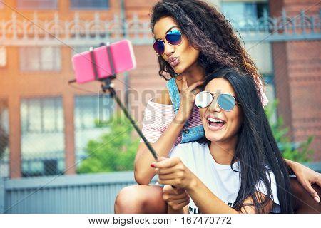 Duo Of Happy Friends Taking A Self Portrait