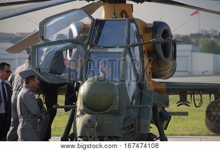 ANKARA, TURKEY - JUNE 10 2014 : Turkish President Abdullah Gul in the cockpit of Turkish Land Forces Aviation Command