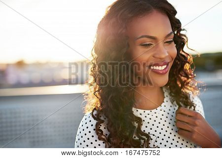 Beautiful afro american woman on a blurry background smiling