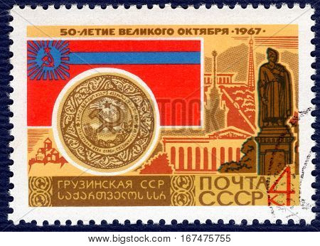 USSR - CIRCA 1967: post stamp printed in the USSR shows Coat of Arms, Flag and monument Georgian Soviet Socialist Republic, serie