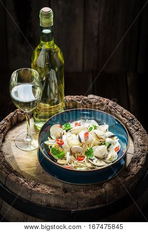 Enjoy Your Spaghetti Vongole Made Of Clams, Peppers And Parsley