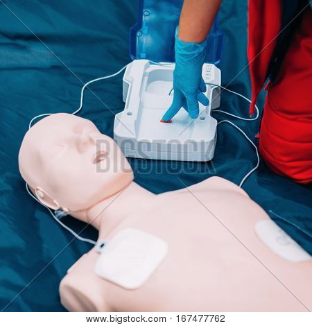Cpr training outdoors in park, color image