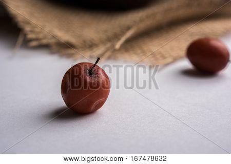 Organic Indian Jujube or ber or berry (Ziziphus mauritiana) moody lighting, selective focus