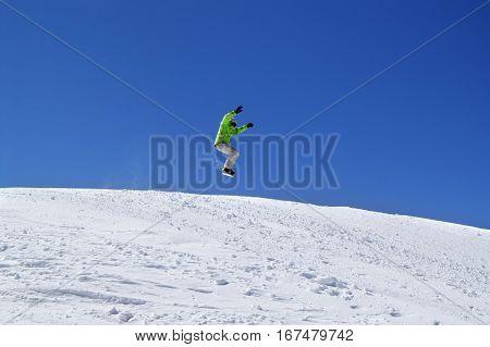 Snowboarder Jump In Snow Park At Ski Resort On Sun Day