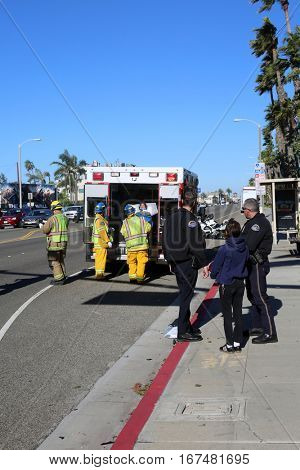 Sunset Beach, California - JANUARY 27, 2017: Sunset Beach- Huntington Beach Fire, Police and Ambulance services tend to a major traffic collision taking the injured to the hospital for treatment.