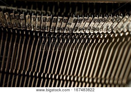 Closeup of an old typewriter letter and symbol keys